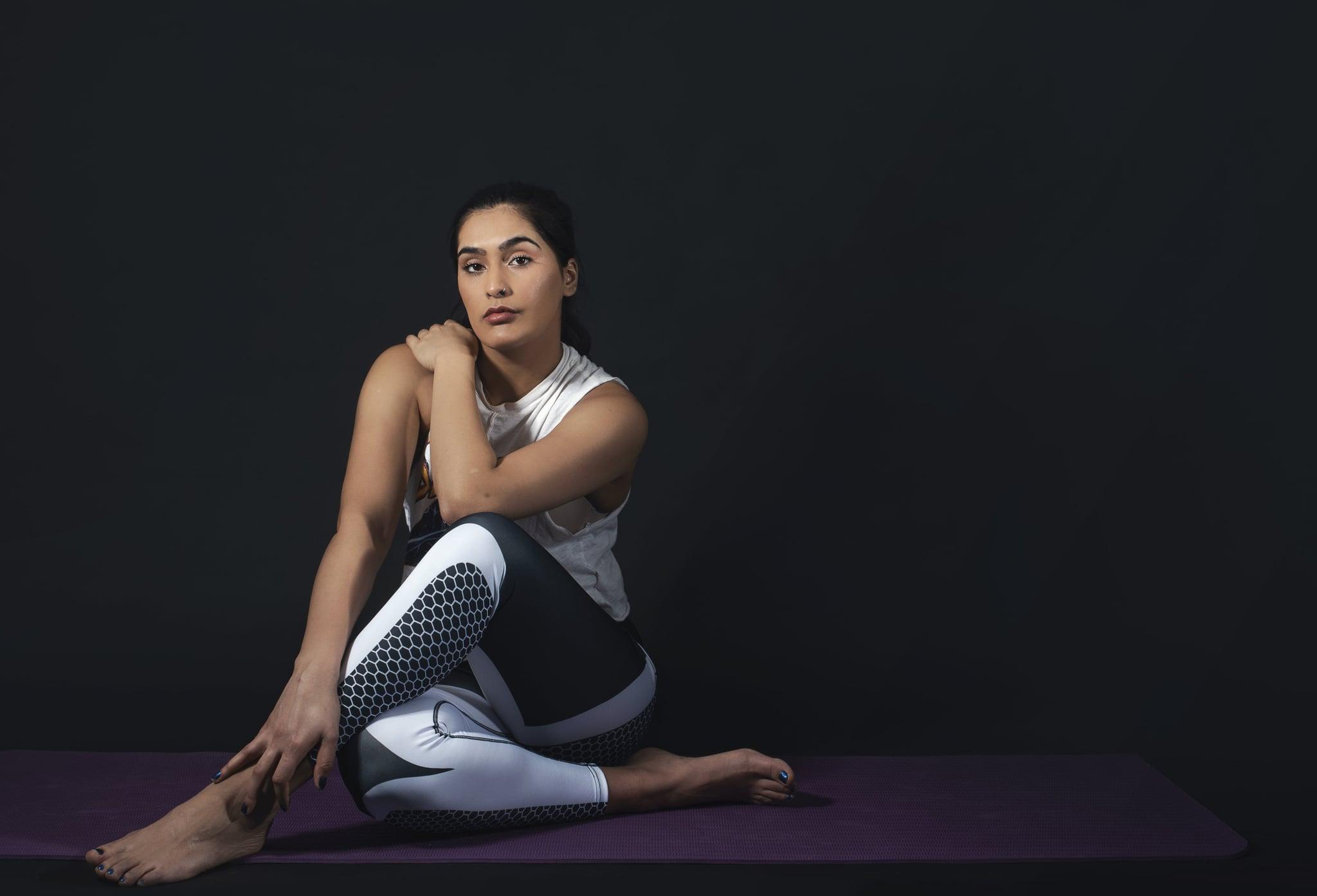 tmp_0VL2hW_924713eef6c3fb8d_woman-sits-in-yoga-pose.jpg