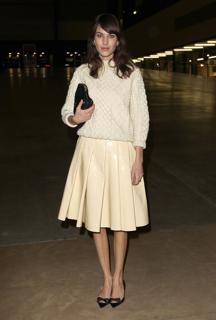 Alexa Chung created a sweet look for the J.W. Anderson show by matching up an ivory knit sweater with a matching pleated skirt. She finished it all off with adorable pointy bow flats and a black clutch.