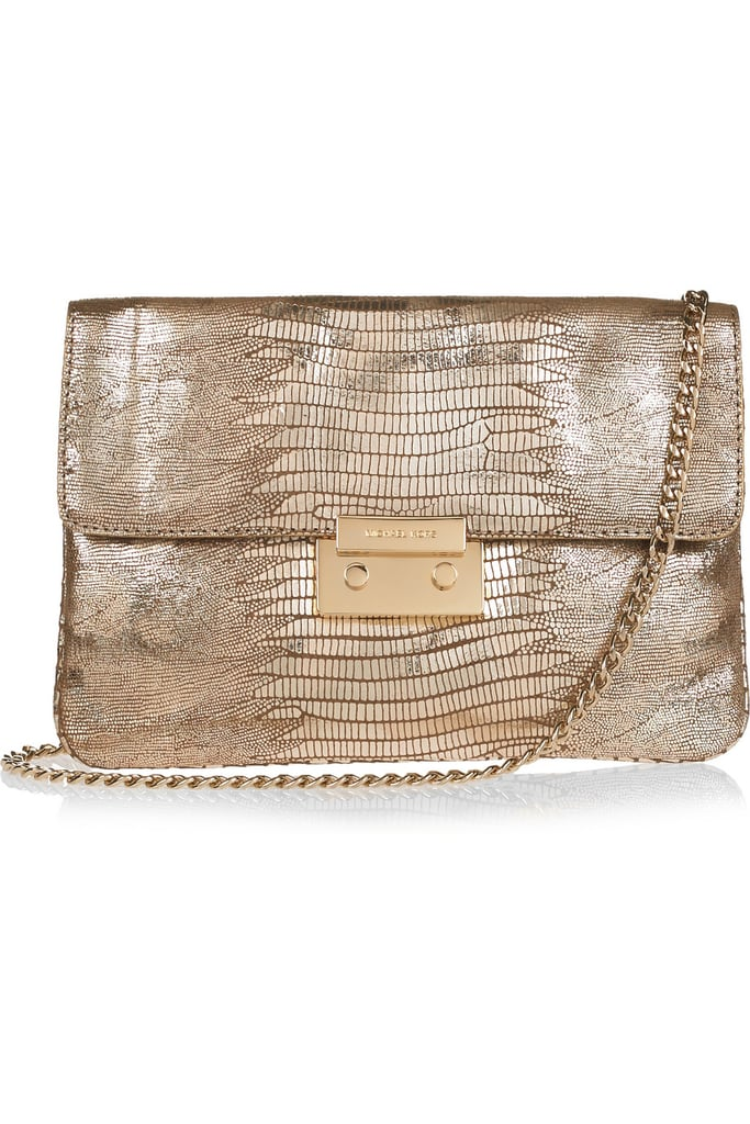 Pairing a golden sheen with a cool lizard texture, this clutch-cum-purse can do double-duty as a dressy daytime add-on and for a sleek evening finish. Michael Michael Kors Sloan Lizard-Effect Leather Clutch ($220)