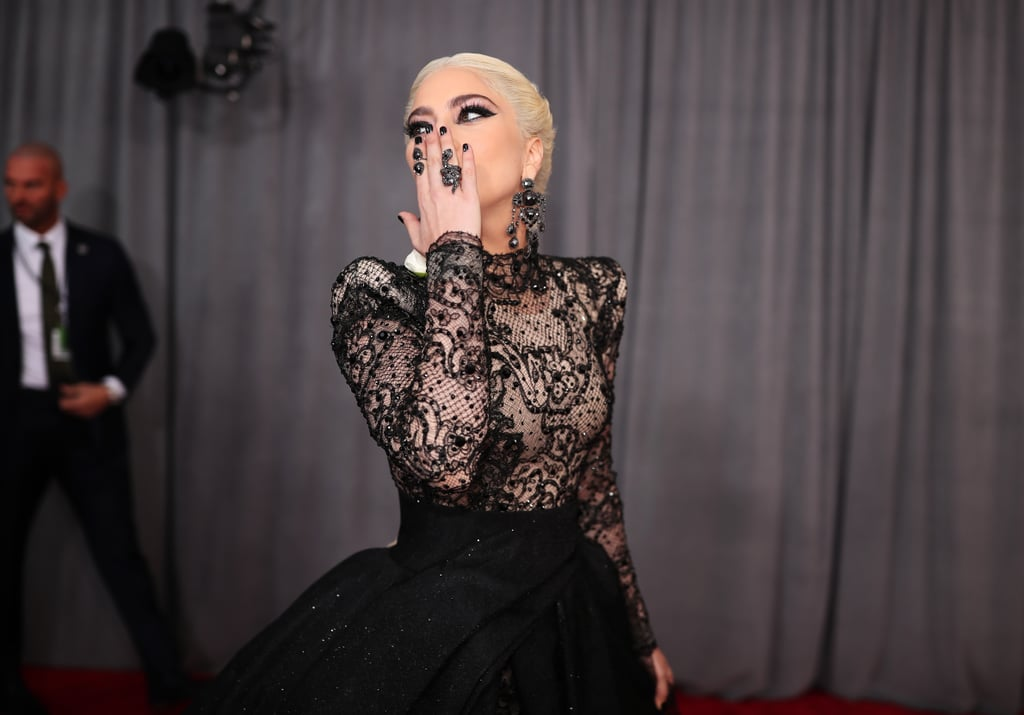 "Lady Gaga made jaws drop when attended the Grammys on Sunday night. The ""Million Reasons"" singer, who is nominated for two awards, looked absolutely stunning as she stepped out on the red carpet in an extravagant black lace gown and a white rose in support of the Time's Up movement. Of course, we couldn't help but focus in on the gorgeous pink sparkler on her ring finger. While the singer has yet to confirm her engagement to boyfriend Christian Carino, the two were recently spotted enjoying a sweet date night in the city ahead of the show. Aside from serving looks as she posed for the cameras, Gaga also shared a sweet moment with her friend Tony Bennett during an interview. Seeing that she's performing during the show, we're sure there are even more exciting moments to come."
