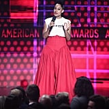 Tracee topped a dramatic pair of pants with a poignant message tee.