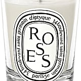 """""""Again with the rose…told you I am a rose-scent junkie. Candles are a great gift for anyone on your list. I love Diptyque because they look chic and cool on display, but also fill your house with beautiful scents and gives a sort of nostalgia. """"   Diptyque Rose Scented Candle ($62)"""