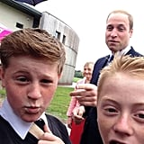 """A schoolboy in East Riding of Yorkshire, England, snapped what he called a """"cheeky"""" photo of Prince William when the royal visited his school in June 2014. Source: Twitter user RaspinJack"""