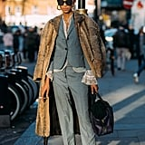 Make a tailored pant suit look cool and wear it with Vans sneakers.