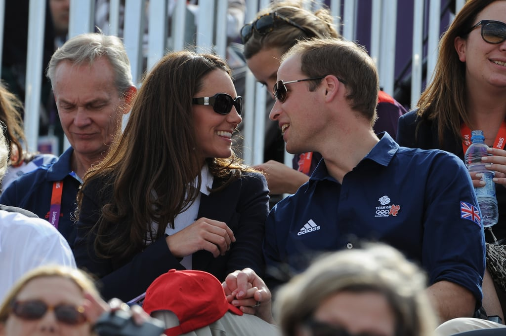 Kate Middleton and Prince William were back in the spotlight at the Olympics in London today. They joined Camilla, Duchess of Cornwall, Prince Harry, Princess Eugenie, and Princess Beatrice to watch a cross-country equestrian event at Greenwich Park. The queen's granddaughter, Zara Phillips, was in competition for the second round, after making her Olympic debut yesterday. Kate chose a navy blue blazer and jeans for the appearance and showed her support for Team GB with a white shirt.  It's an exciting time for the royals, as they'll be attending multiple events throughout the Games. Kate, William, and Harry helped kick off the Olympics at Friday's opening ceremonies. On Saturday, William watched a soccer match with David Beckham and his son Brooklyn.