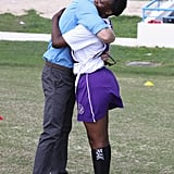 Harry hugged a young participant in a youth sports festival at Antigua's Sir Vivian Richards Stadium in 2016.