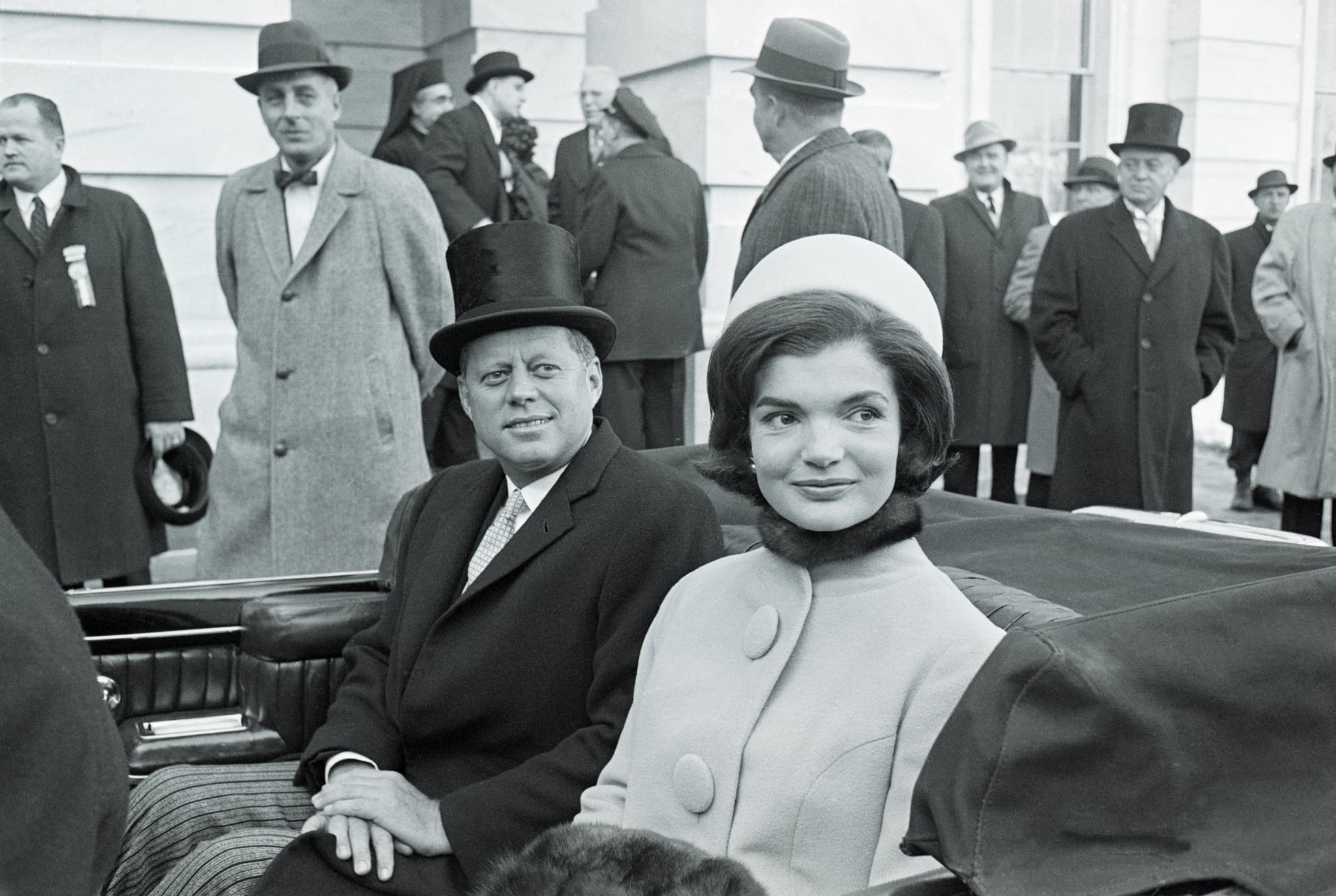 (Original Caption) 1/20/1961-Washington, DC-MArried couple, US President John F Kennedy (1917 - 1963) and First Lady Jacqueline Kennedy (nee Bouvier, later Onassis, 1929 – 1994) leave the capital building by car shortly after the former took the oath of office as President of the United States, Washington DC, January 20, 1961. President Kennedy, 43, the youngest man ever elected to the Presidency called for a global alliance against