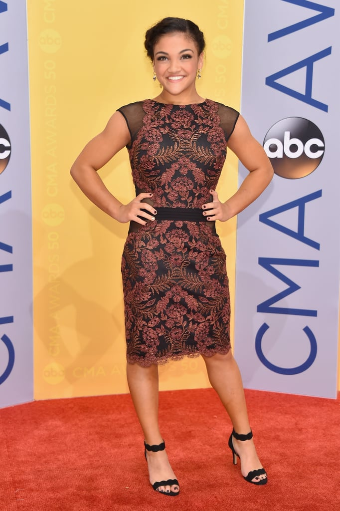 Laurie Hernandez and her fellow Final Five team members attended (and presented at!) the CMA Awards in Nashville on Nov. 2. Despite the fact that the gold medal-winning squad dazzled in unison on the red carpet, we couldn't help but notice 16-year-old Laurie's fun-yet-sophisticated cocktail dress of choice. The Puerto Rican gymnast, who is currently excelling on Dancing With the Stars, opted for a copper-toned Fall '16 Tadashi Shoji bodycon number with sheer mesh sides. Laurie paired the sleek piece with black velvet sandals, Csarite Fine Jewelry by Erica Courtney drop earrings, and the cutest sideswept updo. Keep scrolling to zoom in on all the sparkly details and shop the look, then relive Laurie's jaw-dropping Olympics experience.      Related:                                                                                                           Don't Scroll Too Fast or You'll Miss Every Sparkly, Stunning Detail From the CMA Awards Red Carpet