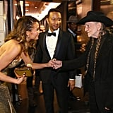 Chrissy Teigen shook Willie Nelson's hand.