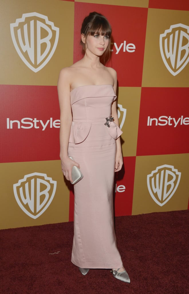 Felicity Jones was the picture of pink perfection in a structural strapless gown, with only the simplest silver accents to offset the pastel hue.