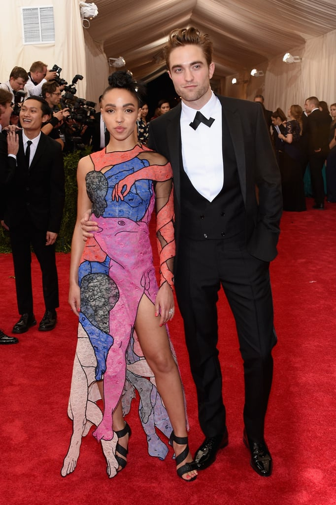 Robert Pattinson and FKA Twigs surprised fans by showing up at the Met Gala in NYC on Monday night. The couple made their way to the East Coast on Sunday and stepped out for a dinner date later that night holding hands. Monday's event is Rob and Twigs's first official red carpet appearance since news of their engagement was confirmed in early April. Twig's engagement ring was on display as she posed for photographers alongside Rob. There are even more stars at the annual event, so make sure to check out all the hot couples and see what everyone's wearing.