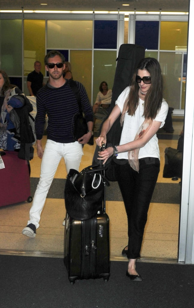 Anne Hathaway and Adam Shulman touched down at JFK.
