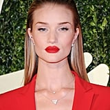 With her hair slicked back, Rosie Huntington-Whiteley's bright red lipstick popped.