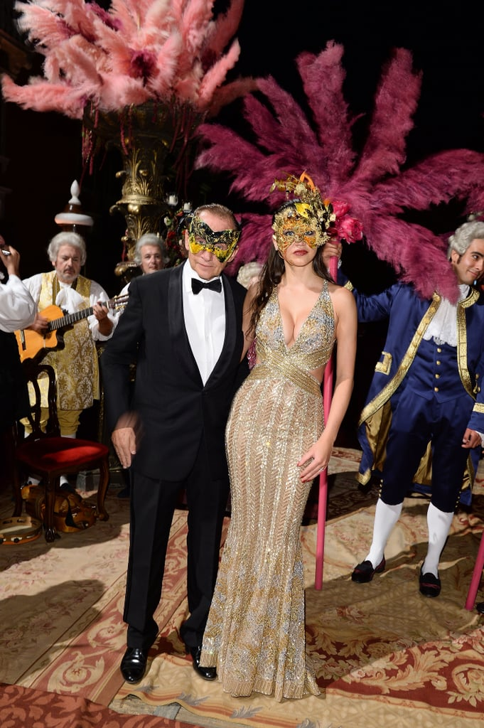 Leona Koing was golden as she dressed in metallics alongside Peter Koing at Dolce & Gabbana's masquerade ball.