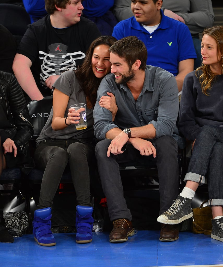 Chace Crawford checked out the Knicks game at Madison Square Garden with a female friend on Friday night. The NY team took home the win against the Charlotte Bobcats, but it doesn't look like Chace spent much time watching the game. Instead he cuddled up to model Rachelle Goulding, and the duo smiled and laughed in their courtside seats.  Aside from stepping out at the Weinstein Company's pre-Oscars party weeks ago, Chace has been lying low since wrapping the final season of Gossip Girl last year. He did make news in February for voicing his interest in playing Christian Grey, though no actor has been confirmed for the lead role in the big-screen adaptation of Fifty Shades of Grey.