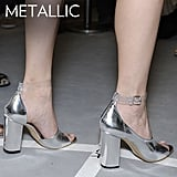 Why we love them: Metallic heels feel entirely new and fresh for the season. They've got a slight futuristic quality that's sleeker and cleaner than sequined shine — and they work for night and day. How to wear them: Don't be intimidated by the shine — most pairs are subtle enough to pull off for day, especially in flat versions. Counter the slick finish with print play, like a great floral-print jean or botanical pencil skirt. Keep your proportions easy with a slouchy sweater or looser t-shirt on top for a more casual vibe.  Photo: 3.1 Phillip Lim Spring 2012