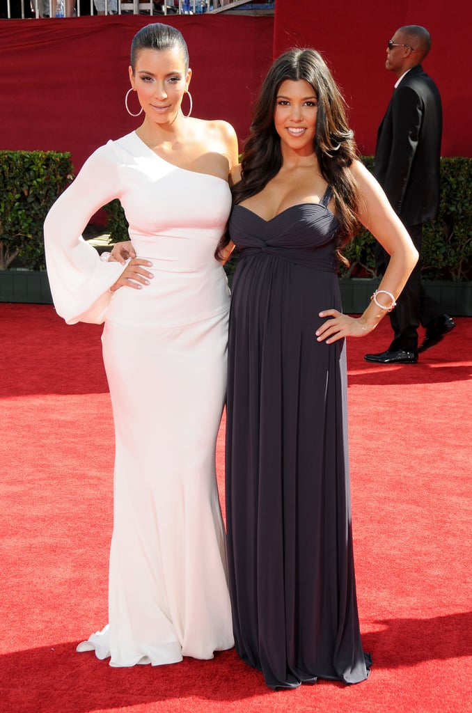 Kim Kardashian posed with her sister Kourtney at the Emmys in LA in September 2009.