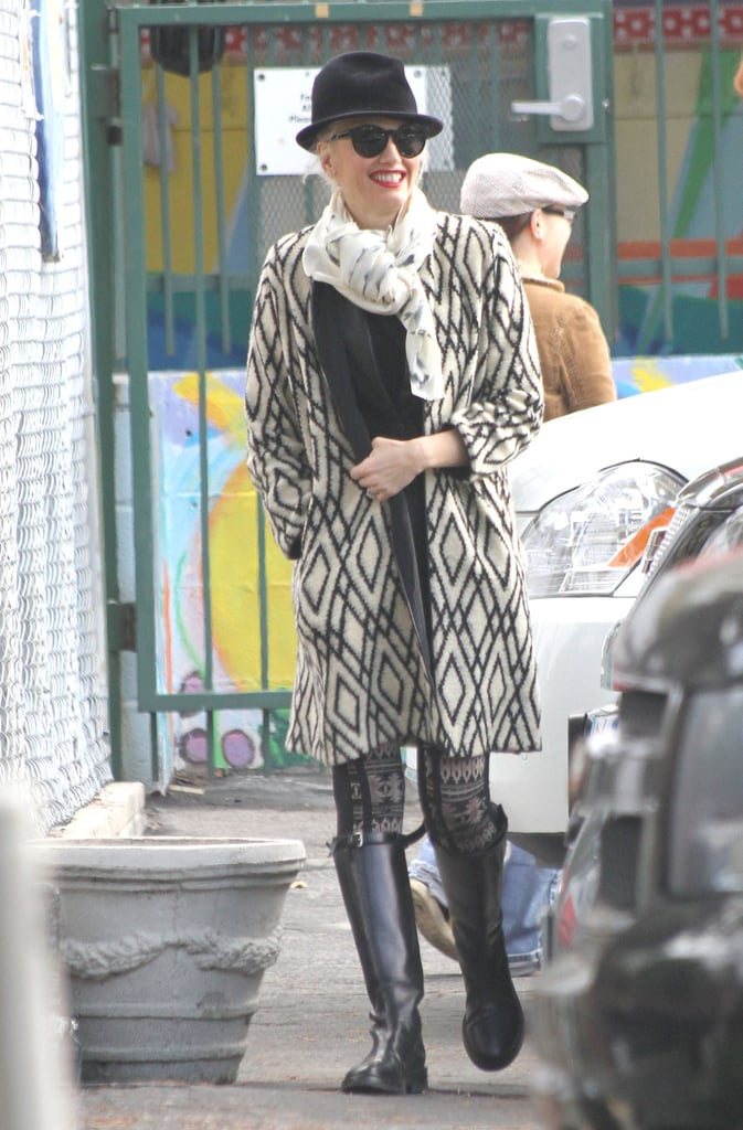 """Gwen Stefani was decked out in a printed Tucker coat and black wide-brimmed hat for a Starbucks stop in LA yesterday. The singer brought son Zuma Rossdale along for the outing, and the two enjoyed their drinks while heading back to the car. Gwen's getting back to the daily grind after wrapping up a string of concerts with No Doubt last night. The band performed six sold-out shows at LA's Gibson Amphitheatre to promote its latest album, Push and Shove. While Gwen shows off her six-pack abs and toned legs on stage, she has been quick to admit that it doesn't come easy. Gwen recently told Marie Claire UK that she has """"kind of stopped working out"""" because her body """"needed a break."""""""