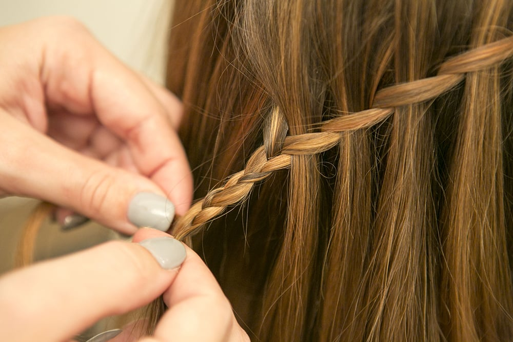 Once you reach the end, extend the woven section of hair with a regular three-strand braid and secure with a clear elastic.