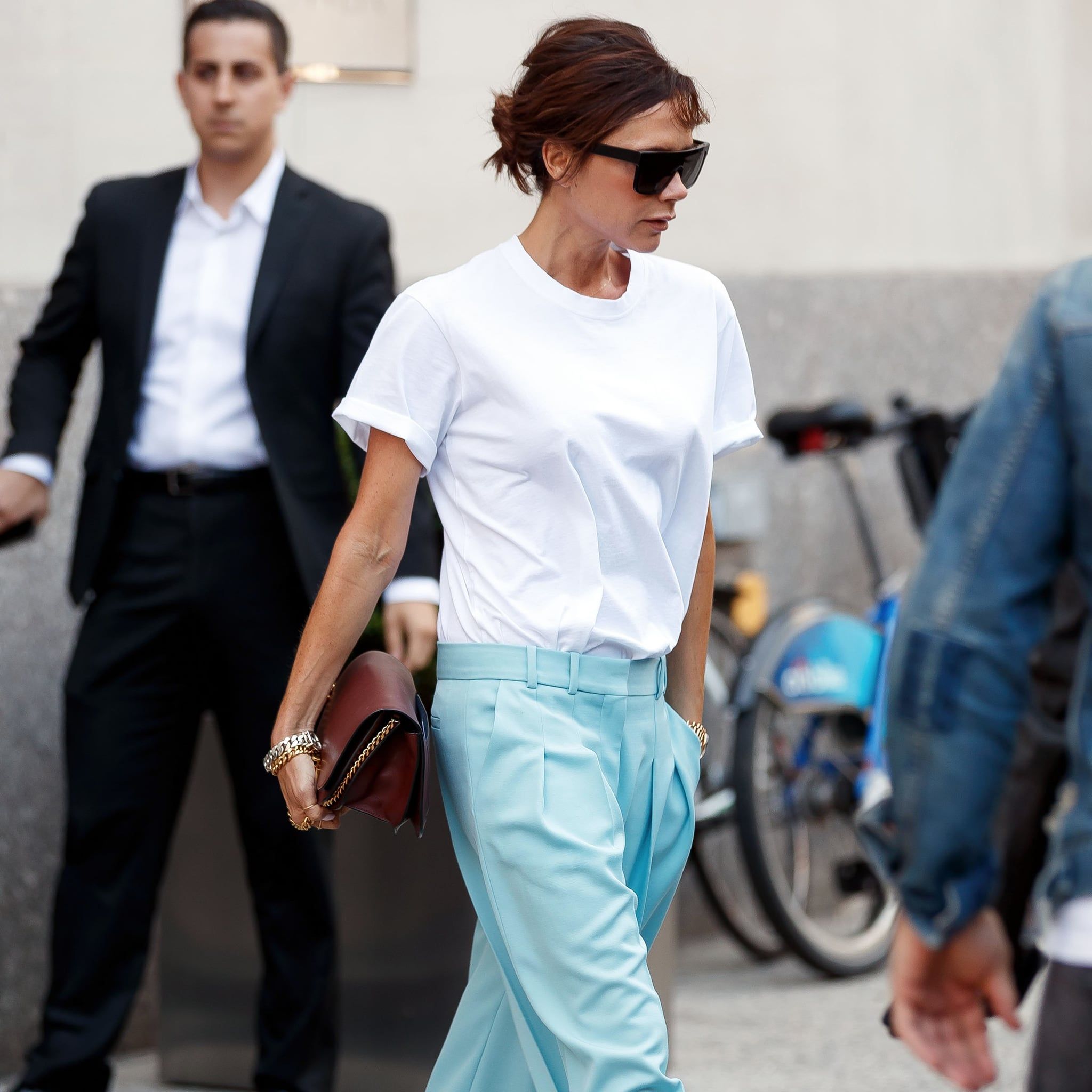 02631b507 Victoria Beckham Wears White T-Shirt and Blue Pants | POPSUGAR Fashion UK