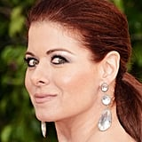 Debra Messing accessorized with oversized, dangling earrings.