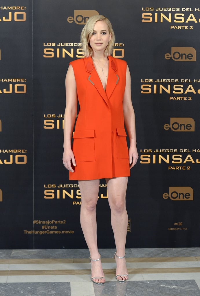 Who could forget Jen's bright take on the tuxedo dress, a Mugler design that packed a punch when paired with Jimmy Choo metallic sandals? Jen chose this number for The Hunger Games: Mockingjay Part 2 photo call in Spain.