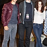Taylor Lautner, Robert Pattinson, and Kristen Stewart joined arms for a photo at Comic-Con in 2011.
