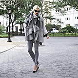 Shades of gray are intensified by black accessories like sunglasses and scarves.