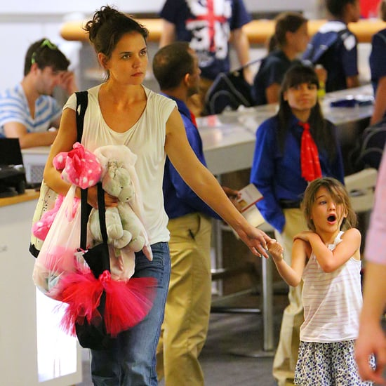 Katie Holmes and Suri Cruise Fly Commercial