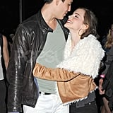 Emma Watson and her man cuddled up during a show.
