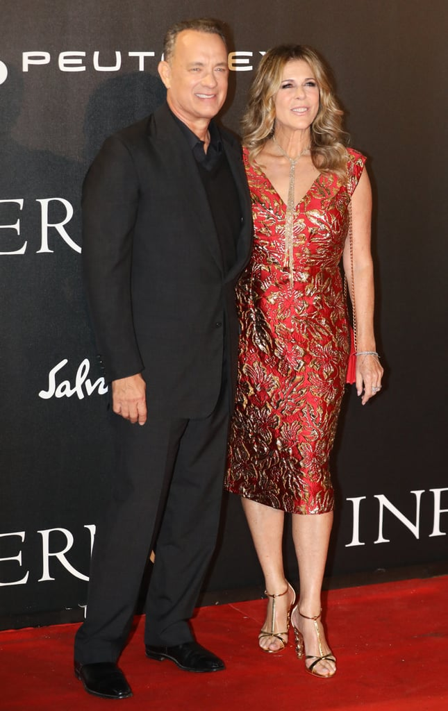 Tom Hanks had the support of his lovely wife, Rita Wilson, at the premiere of Inferno in Italy on Saturday. The couple, who celebrated 28 years of marriage this year, looked lovely as they posed for pictures together on the red carpet. Rita dazzled in a gorgeous red dress, while Tom looked dapper as usual in an all-black suit. In the movie, which is the third film in the Da Vinci Code franchise, Tom reprises his role as Robert Langdon and teams up with Sienna Brooks (Felicity Jones) in a race against time. Check out the trailer for Inferno before it hits theaters on Oct. 28.