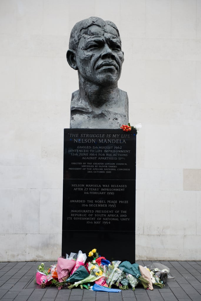 Bouquets sat at the base of a Nelson Mandela bust in London.
