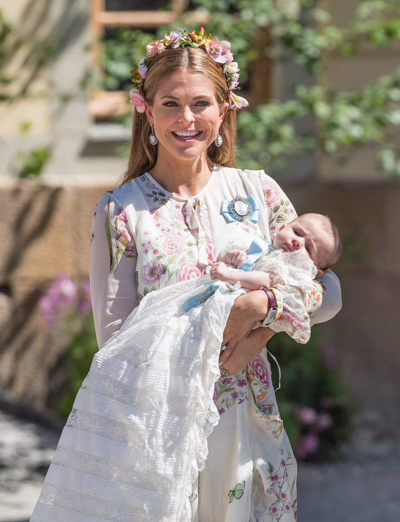 The Swedish royal family stepped out to support the christening of Princess Adrienne at the Royal Chapel in Stockholm on Friday. The adorable tot, who was welcomed into the world in March to parents Princess Madeleine and Chris O'Neill, wore the same gown worn by her siblings Princess Leonore and Prince Nicolas at their christenings, People reports. King Carl Gustaf and Queen Silvia were in attendance to witness their granddaughter's baptism, along with Princess Victoria, Prince Daniel, Prince Carl Philip, and Princess Sofia, who posed for a group photo outside the chapel. While we wait for Prince William and Kate Middleton's christening of baby Prince Louis, which will likely take place in July, scroll through to see more sweet photos from Adrienne's big day.