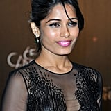 Freida Pinto wore bright pink lipstick to the opening night dinner at the Cannes Film Festival.