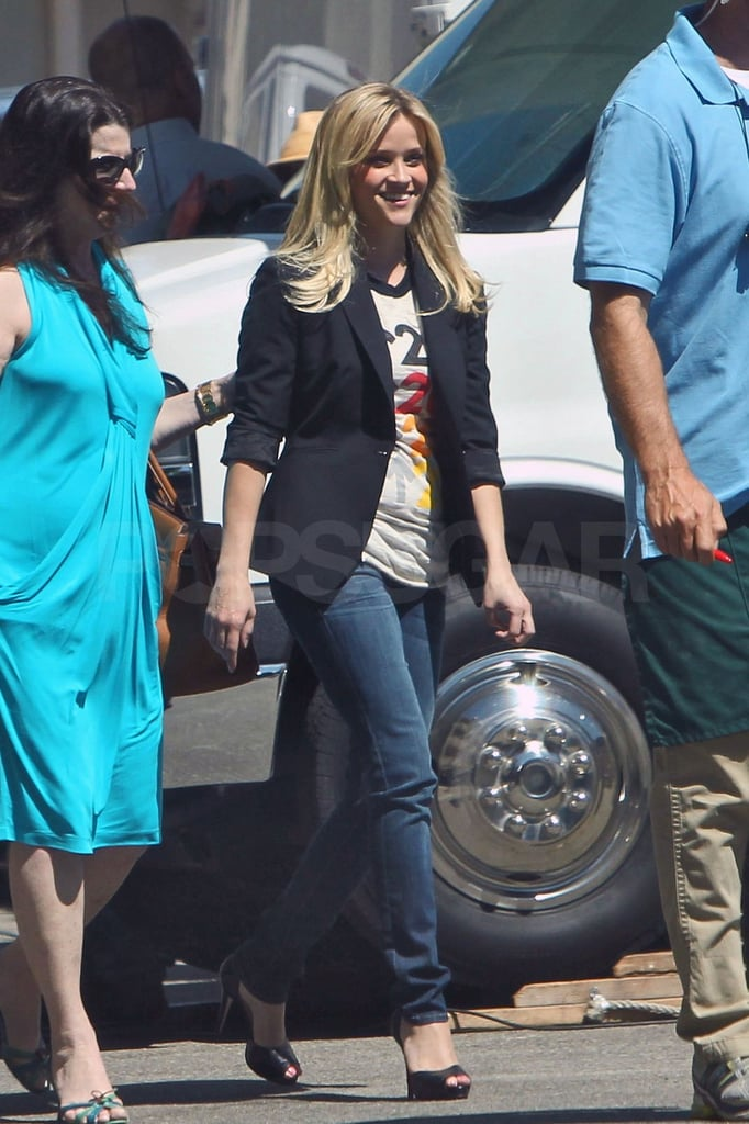 A smiling Reese Witherspoon arrived on the LA set of a commercial yesterday in a Stand Up 2 Cancer t-shirt and skinny jeans. Reese has a long-standing relationship with the SU2C organization, in addition to her ongoing philanthropic work with Avon's Walk for Breast Cancer campaign. Her Avon ambassador responsibilities took Reese around the globe earlier this month to celebrate the company's 125th anniversary. Reese made fashionable stops in Moscow and Warsaw, also handing out large donations to domestic violence organizations along the way. Her travel plans continued closer to home over the weekend when Reese, Jim Toth, Ava, and Deacon Phillippe visited Nashville together.