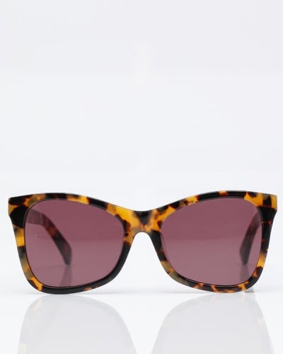 These shades are classic, with a hint of the cat-eye — they'll go with everything.  Karen Walker Perfect Day Sunglasses ($220)