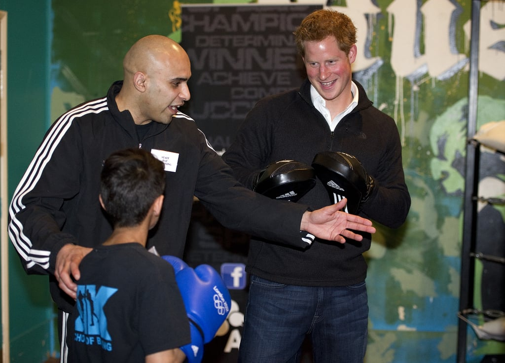 Prince Harry smiled during his visit to the KK Boxing Club.