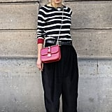 A bold, striped shirt gave these slouchy pants a Parisian-chic finish.