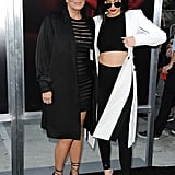 As she adjusted her look, Kylie gave us an even better view on her outfit underneath, which was a black crop top and a pair of black pants.