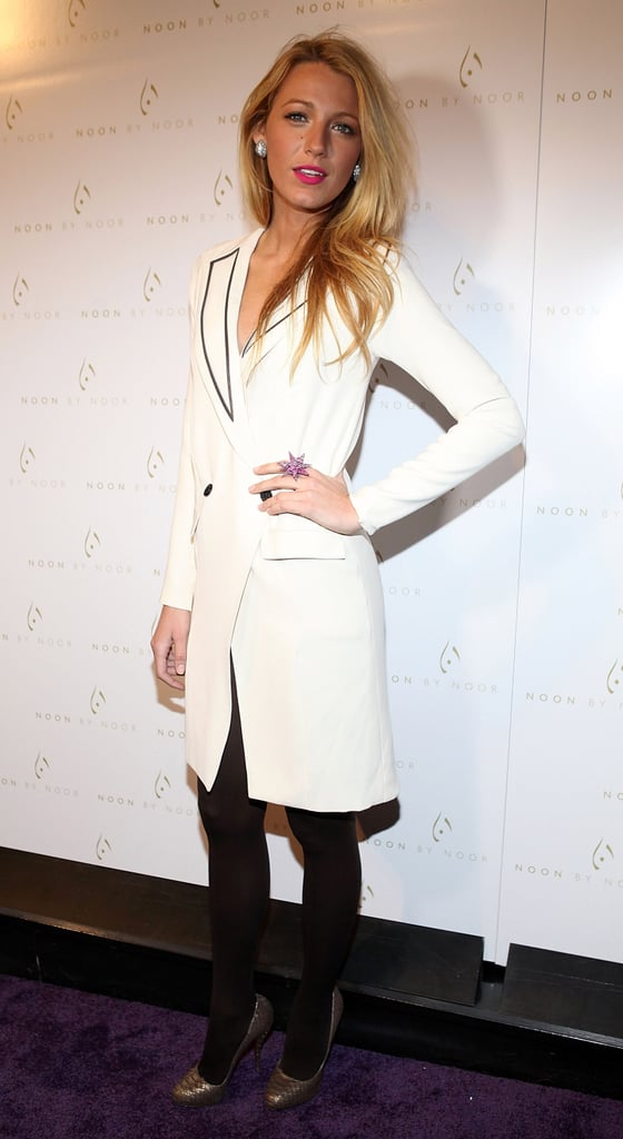 Blake Lively attended the Noon by Noor show wearing an embellished tuxedo shirtdress by the brand paired with black tights and a reptilian-print pumps.