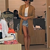 Chrissy Wore Her Cutoffs With a White Tee, Khaki Duster, Wide-Brim Hat, and Neutral Heels