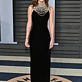 For the 2018 Vanity Fair Oscars party, Emma wore a vintage Ralph Lauren dress, Roger Vivier shoes, and Ana Khouri jewelry.