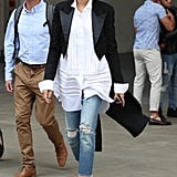 Zendaya wore her tailcoat with a long shirt with pintucks and ripped jeans
