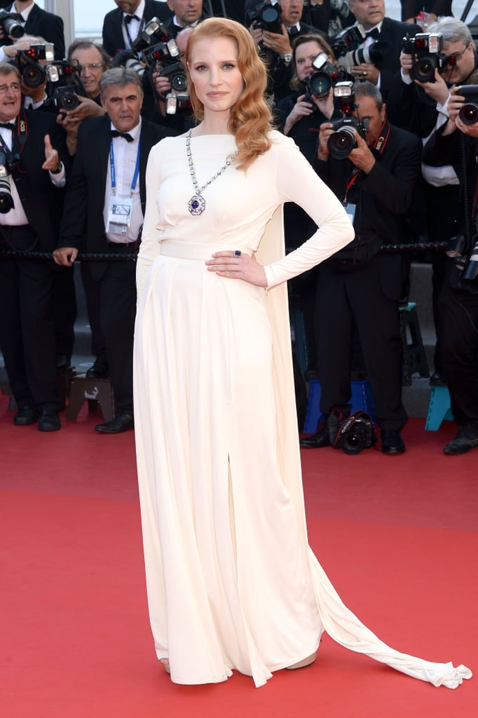 "To highlight the stunning Bulgari necklace, or as Jessica Chastain called it, ""a symbol of their epic love,"" she wore an understated cream-coloured Versace Collection gown from the label's not-yet-debuted Spring 2014 collection."