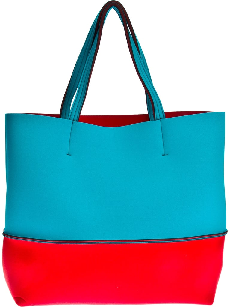 With frequent beach trips planned this Summer, I need a cool carryall to hold all of my necessities. I adore this Leghilá neoprene tote ($161) because the neoprene textile makes it water-repellant and I can't get enough of the bold colorblocked detail. — Chi Diem Chau
