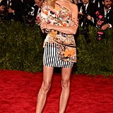 At the 2013 Met Gala in NYC, Karolina Kurkova edged up her funky minidress via studded ankle-strap pumps.