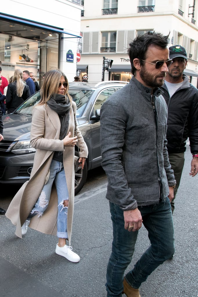 Even in Paris in 2017, the two kept their outfits casual, which meant they blended right in with the crowd. Jennifer wore a beige duster coat and grey scarf while Justin also matched in a grey hoodless jacket.