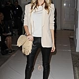 A pair of exotic pumps furthered the textural play between Poppy Delevingne's slick leather pants and fringed bag.