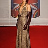 Rihanna accentuated her Givenchy gown with leather gloves.