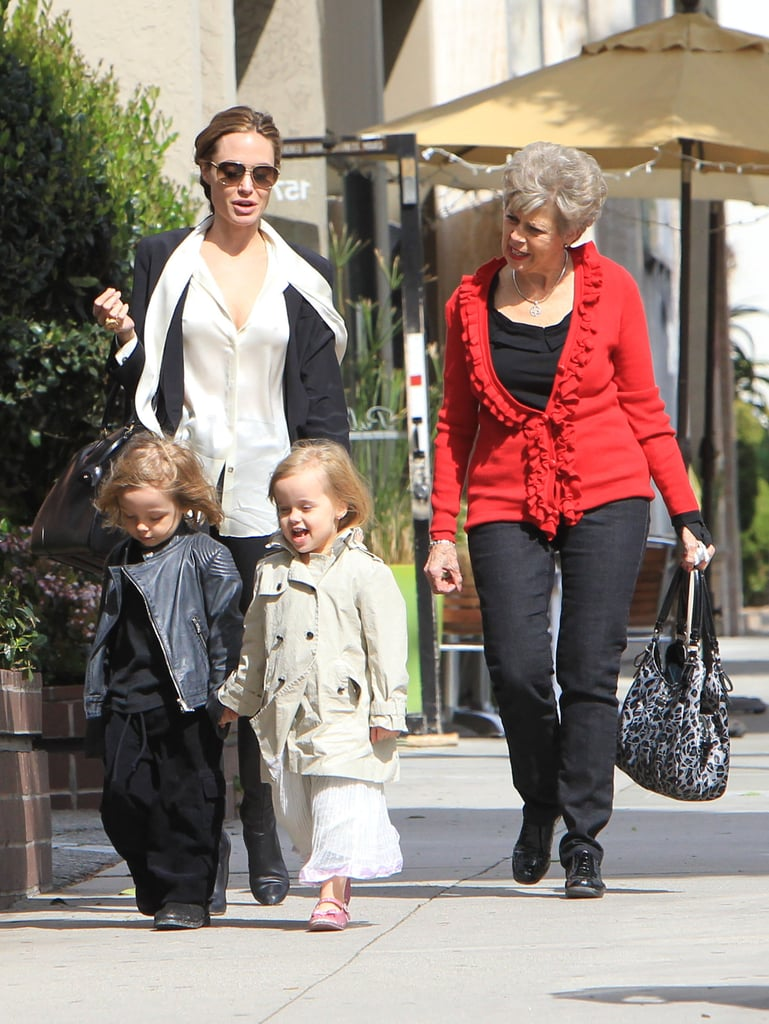 Angelina Jolie shopped in LA this afternoon with her youngest children, Knox and Vivienne Jolie-Pitt. Also along for the retail outing to Auntie Barbara's Kids Boutique was Brad's mother, Jane Pitt. Angelina spent the day with family after hitting the red carpet at yesterday's Oscars. In Atelier Versace, Angelina Jolie turned more than a few heads thanks to a serious slit in the black velvet gown. She presented honors to the year's best screenwriters, and one group of honorees, from The Descendants, playfully mocked Angelina's onstage pose. The gesture didn't seem to bother Angelina much, as she and Brad segued right into their afterparty fun. Brad and Angelina met up with George Clooney, Emily Blunt, John Krasinski, and Salma Hayek at a private bash Clooney hosted at Craig's restaurant.